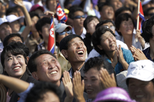 North Koreans watch an aerial display on Saturday, September 24, 2016, in Wonsan, North Korea. (Photo by Wong Maye-E/AP Photo)