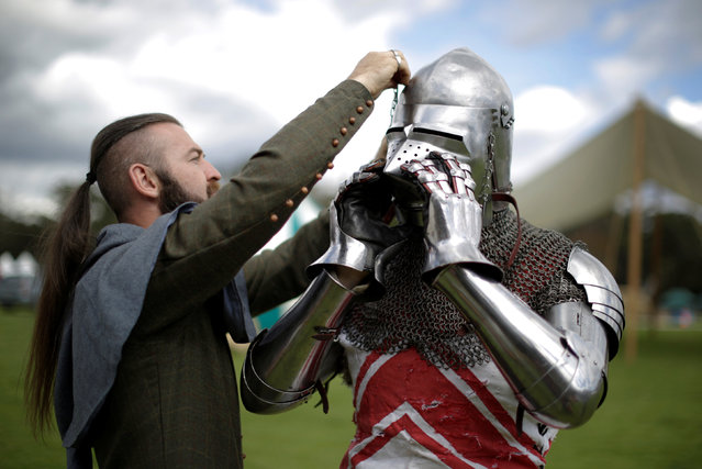Australian electrician Hugh McDonald (R), has his jousting outfit adjusted by tournament marshall Anthony Rush on the sidelines of the jousting tournament at the St Ives Medieval Fair in Sydney, one of the largest of its kind in Australia, September 22, 2016. (Photo by Jason Reed/Reuters)