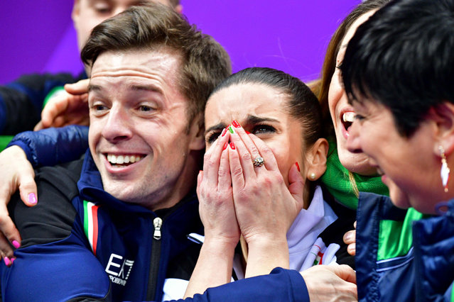 Italy's Valentina Marchei (C) and Italy's Ondrej Hotarek (L) react after competing in the figure skating team event pair skating free skating during the Pyeongchang 2018 Winter Olympic Games at the Gangneung Ice Arena in Gangneung on February 11, 2018. (Photo by Mladen Antonov/AFP Photo)