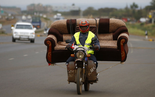 A man carries a sofa on his motorcycle on a highway near Kenya's capital Nairobi on March 11, 2013. (Photo by Marko Djurica/Reuters)