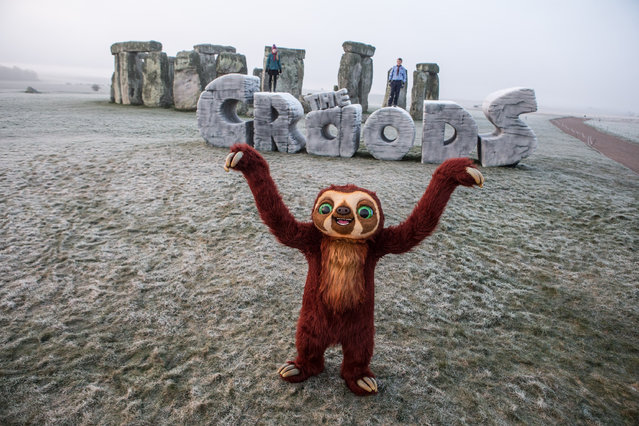 "19th March 2013: In celebration of the Spring Solstice 2013 and in conjunction with the release of Twentieth Century Fox's 3D animation 'THE CROODS' - a family animation centered around the first ever pre historic road trip - a giant monument was erected at Stonehenge at sunrise today, Tuesday 19th March.  This marks the first time a modern structure has EVER been allowed on this historic site. The Spring Solstice or 'Vernal Equinox' recognises the first day of spring and each year sees druids and pagans gather at Stonehenge early in the morning to watch the sun rise above the prehistoric stones.  This year an additional monument, in the shape of 'THE CROODS', will become part of these special celebrations at daybreak. 'Meet the first modern family, THE CROODS, whose world is rocked by generational clashes and seismic shifts that come to a head on a wild road trip filled with dazzling adventures, amazing firsts (like fire…and shoes), never before seen creatures and the epic discovery that they'll have to stay one step ahead of the ever-changing world or get left in the prehistoric dust.' DreamWorks Animation SKG presents THE CROODS. The film is directed by Chris Sanders & Kirk DeMicco, and produced by Kristine Belson and Jane Hartwell.  The screenplay is by Kirk DeMicco & Chris Sanders, with a story by John Cleese, Kirk DeMicco and Chris Sanders. The music is by Alan Silvestri. The film stars Nicolas Cage as Grug, Ryan Reynolds as Guy, Emma Stone as Eep, Catherine Keener as Ugga, Clark Duke as Thunk, and Cloris Leachman as Gran. THE CROODS presents an age known as the Croodaceous Period, which, says DeMicco, ""fell between the Jurassic Age and the 'Katzenzoic Era'– at least according to DreamWorks archaeologists."" It is a world of visual splendor and grandeur that holds innumerable challenges for the beleaguered clan"
