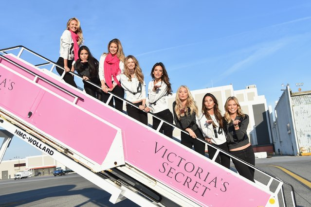 (L-R) Victoria's Secret Models Candice Swanepoel, Adriana Lima, Doutzen Kroes, Behati Prinsloo, Alessandra Ambrosio, Lindsay Ellingson, Lily Aldridge, and Karlie Kloss depart for London for the 2014 Victoria's Secret Fashion Show at JFK Airport on November 30, 2014 in New York City. (Photo by Mike Coppola/Getty Images for Victoria's Secret)