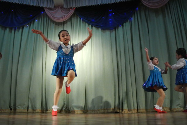 North Korea girls perform for visitors at a nursery school in the northeastern North Korean border town of Sinuiju on December 15, 2012. (Photo by Wang Zhao/AFP Photo)
