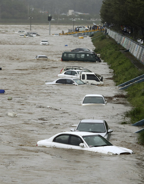 Vehicles are submerged in floodwaters caused by Typhoon Chaba in Gyeongju, South Korea, Wednesday, October 5, 2016. Typhoon Chaba slammed South Korea on Wednesday, bringing heavy rains and raging waves to Jeju Island, an island south of the mainland, and the country's southern cities. (Photo by Kim Jun-bum/Yonhap via AP Photo)