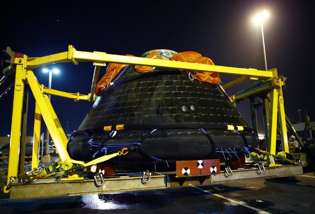 NASA's Orion spacecraft is off loaded from the back of  USS Anchorage at Naval Base San Deigo, California December 8, 2014. (Photo by Mike Blake/Reuters)