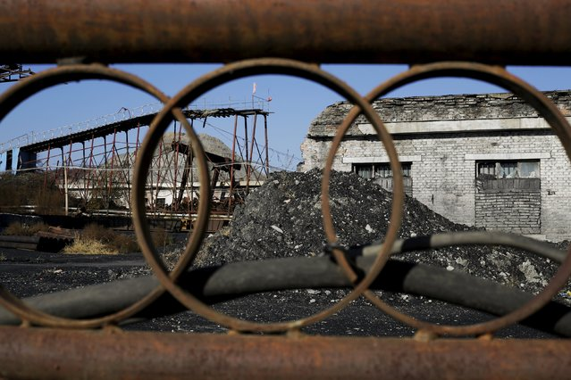 A general view through a closed gate at Ronghua coal mine from the state-owned Longmay Group on the outskirts of Jixi, in Heilongjiang province, China, October 23, 2015. (Photo by Jason Lee/Reuters)