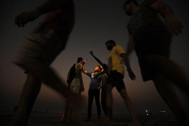 Indian youngsters take selfies at Juhu beach near the Arabian sea shore in Mumbai, India, 05 November 2020. (Photo by Divyakant Solanki/EPA/EFE)