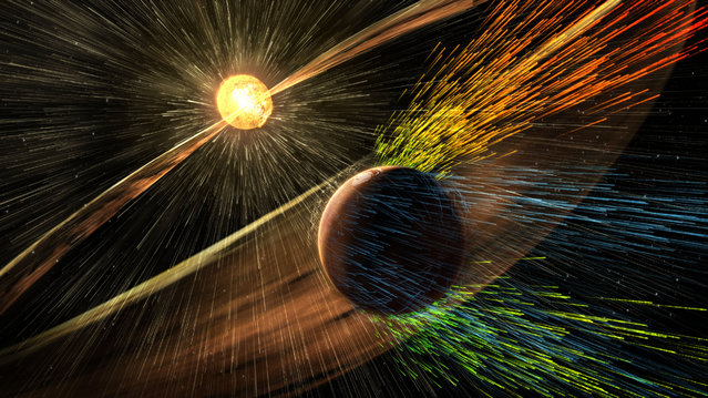 This image made available by NASA on Thursday, November 5, 2015 shows an artist's rendering of a solar storm hitting the planet Mars and stripping ions from the planet's upper atmosphere. NASA's Mars-orbiting Maven spacecraft has discovered that the sun robbed the red planet of its once-thick atmosphere and water. On Thursday, scientists reported that even today, the solar wind is stripping away about 100 grams of atmospheric gas every second. (Photo by Goddard Space Flight Center/NASA via AP Photo)