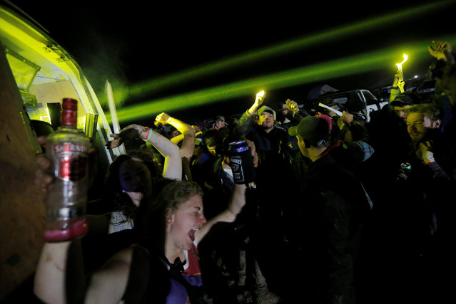 Revellers dance to a DJ's music blasting from a van on the final night of the Deni Ute Muster in Deniliquin, New South Wales, Australia, October 1, 2016. (Photo by Jason Reed/Reuters)