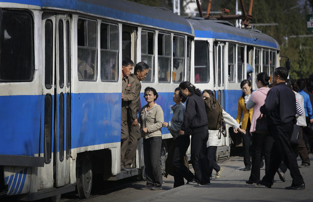 North Koreans get on and off electric trolley buses which is a popular form of public transport around the city on Monday, October 17, 2016, in Pyongyang, North Korea. (Photo by Wong Maye-E/AP Photo)