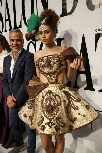 Lebanese designer Abed Mahfouz poses with a model wearing his creation made with chocolate at the end of the Chocolate Fashion Show at the Salon Du Chocolat in Beirut, Lebanon November 12, 2015. (Photo by Jamal Saidi/Reuters)