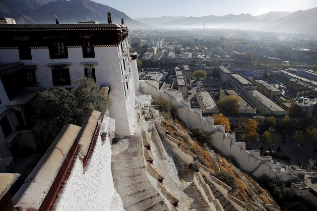 Morning mist covers downtown as seen from atop the Potala Palace in Lhasa, Tibet Autonomous Region, China November 17, 2015. (Photo by Damir Sagolj/Reuters)