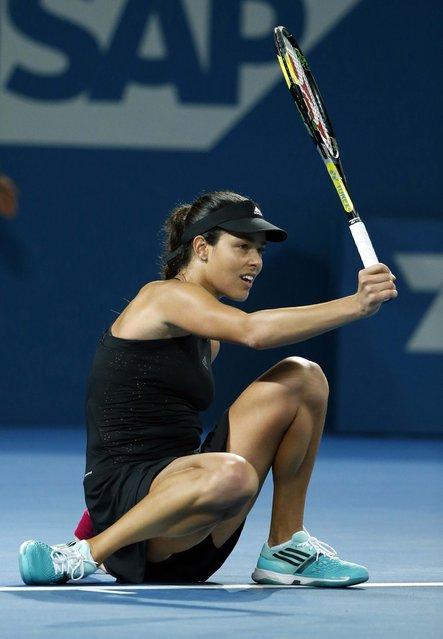 Ana Ivanovic of Serbia sits on the court after missing a shot during her women's singles final match against Maria Sharapova of Russia at the Brisbane International tennis tournament in Brisbane, January 10, 2015. (Photo by Jason Reed/Reuters)