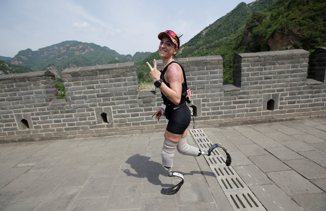 Portuguese runner Adriele Silva gestures during the Great Wall Marathon at the Huangyaguan section of the Great Wall of China, in Jixian of Tianjin, China May 19, 2018. (Photo by Jason Lee/Reuters)