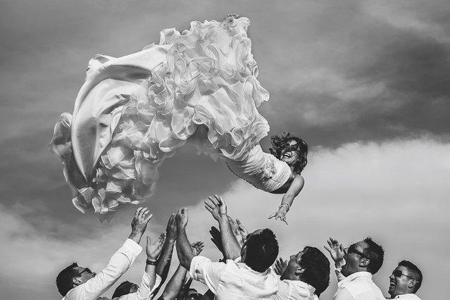 These are the stunningly creative photographs voted as some of the worlds best wedding snaps from the last year. The International Society of Professional Wedding Photographers (ISPWP) Awards features more than 20 categories. From the conventional Bride and Groom Portrait to the vibrant All About Light award. Here: The bride being thrown up buy her Groom and Ushers. 1st place – the wedding dress. Cordoba, Spain. (Photo by Valentin Gamiz/Caters News)