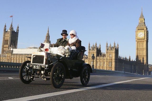 Participants drive their 1904 Swift over Westminster Bridge with the Houses of Parliament in the background, during the London to Brighton Veteran Car Run in London, Sunday November 6, 2016, Hundreds of pre-1905 manufactured vehicles made their way on the historic 60-mile run from Hyde Park in London to coastal Brighton in southern England, in the world's longest running motoring celebration. (Photo by Tim Ireland/AP Photo)