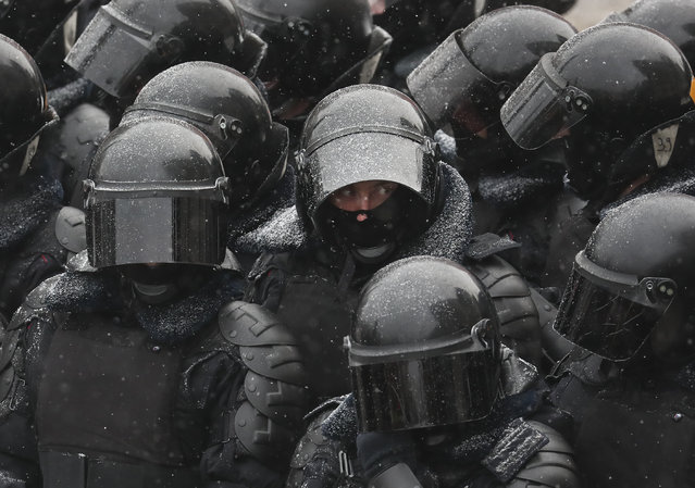 Police stand blocking approaches to the street during a protest against the jailing of opposition leader Alexei Navalny in Moscow, Russia, Sunday, January 31, 2021. (Photo by Andrew Lubimov/AP Photo)