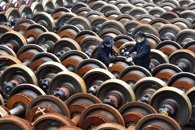 Workers check and maintain train wheels for the Spring Festival travel rush on February 2, 2021 in Wuhan, Hubei Province of China. The 40-day Spring Festival travel rush, also known as chunyun, begins on January 28 and lasts until March 8. (Photo by VCG/VCG via Getty Images)