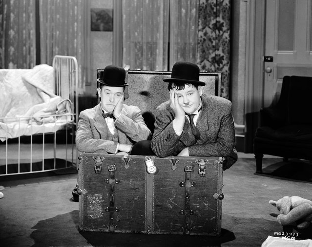 "Stan Laurel (1890 - 1965) and Oliver Hardy (1892 - 1957) in a scene from ""Pack Up Your Troubles"", directed by George Marshall and Ray McCarey, 1932. (Photo via John Kobal Foundation/Getty Images)"