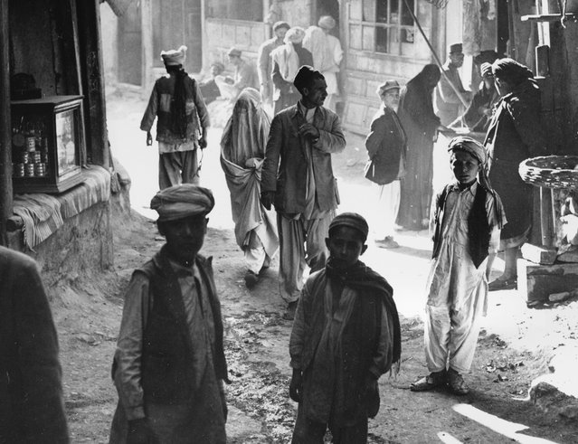 Afghan boys, men, and a woman walk through a street in Kabul, Afghanistan, on March 26, 1954. (Photo by AP Photo via The Atlantic)