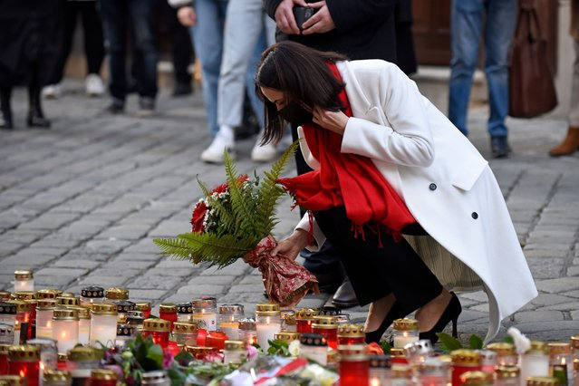 Belarusian opposition leader Svetlana Tikhanovskaya lays flowers at a makeshift memorial of candles and flowers at the scene of a terror attack where last Monday night a gunman rampaged on November 05, 2020 in Vienna, Austria. Kujtim Fejzulai, a 20-year-old with Austrian and North Macedonian citizenship who had been radicalized by Islamic extremism, killed four people and injured 23 others before being shot dead by police. (Photo by Thomas Kronsteiner/Getty Images)