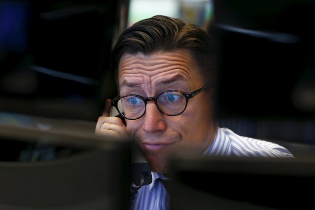 A trader speaks on the phone at his desk at the Frankfurt stock exchange, Germany, in this June 29, 2015 file photo. Federal Reserve policymakers are widely seen raising interest rates for the first time in almost a decade at their next meeting this week. (Photo by Ralph Orlowski/Reuters)