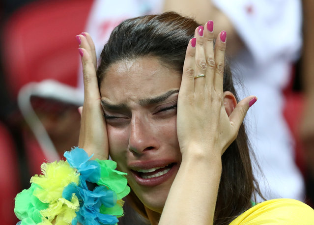 Brazil fan looks dejected after their team lost 2-1 to Belgium in a World Cup quarter final soccer match in Rio de Janeiro, Brazil, Friday, July 6, 2018. (Photo by Sergio Perez/Reuters)