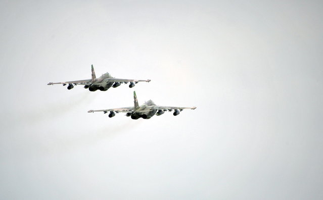Russian Army Su-25 jet fighters fly near the Baikal Lake in Russia on Wednesday, July 17, 2013. (Photo by Alexei Nikolsky/AP Photo/RIA Novosti/Presidential Press Service)