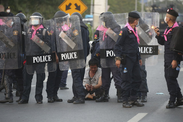 Riot policemen arrest an anti-government protester, during a protest in Bangkok, Thailand, Sunday, February 28 , 2021. (Photo by AP Photo/Stringer)