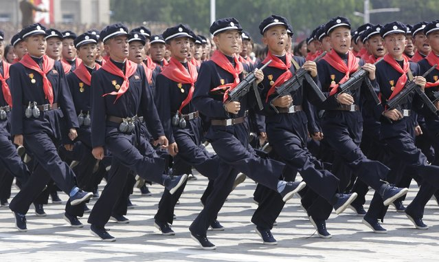 North Korean pioneers march in Pyongyang to mark the 60th anniversary of the Korean war armistice. (Photo by  Reuters)