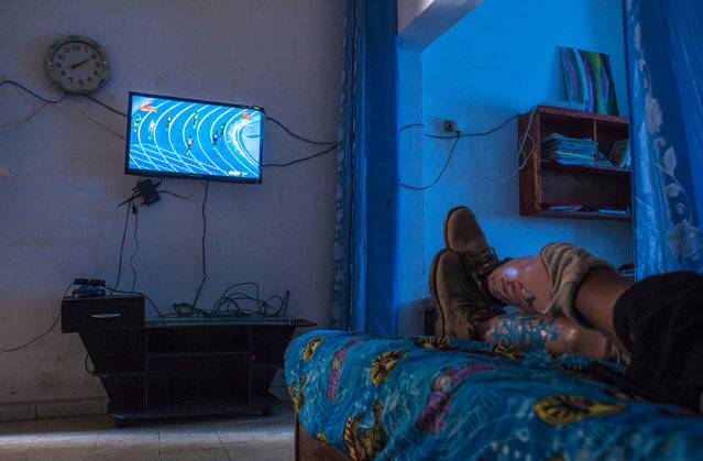 Guesmi pictured watching the 2016 Olympics in his home. (Photo by Yassine Alaoui Ismaili/The Guardian)