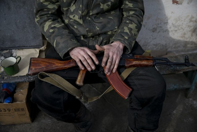 A Ukrainian serviceman rests near Debaltseve, eastern Ukraine, February 8, 2015. (Photo by Gleb Garanich/Reuters)
