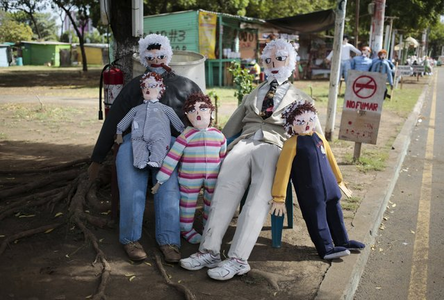 Handmade puppets are seen along the street in Managua, Nicaragua December 30, 2015. (Photo by Oswaldo Rivas/Reuters)