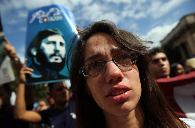 Hundreds of young Cubans gather at Havana University to remember Cuban leader Fidel Castro, who died last night, Havana, Cuba, on 26 November 2016. Current Cuban president, Raul Castro, announced on 25 November 2016 his brother's death on the Cuban state TV. Cuban former President Fidel Castro has died at the age of 90. (Photo by Alejandro Ernesto/EPA)