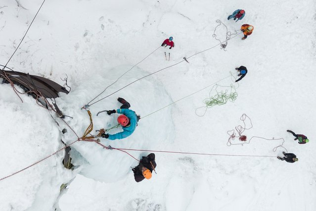 Members of Novosibirsk tourist clubs climb a frozen water tower during the ice training, in the Toguchinsky district of the Novosibirsk region, Russia on March 21, 2021. (Photo by Alexandr Kryazhev/Sputnik/Profimedia)
