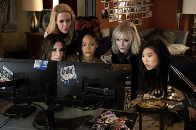 "This image released by Warner Bros. shows, from foreground left, Sandra Bullock Sarah Paulson, Rihanna, Cate Blanchett and Awkwafina in a scene from ""Ocean's 8"". (Photo by Barry Wetcher/Warner Bros. via AP Photo)"