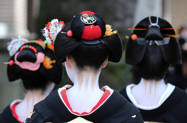 Japanese traditional female dancers, maikos, and performers, geikos attend the new year's ceremony at the Gion Kobu Kaburenjo Theater on January 7, 2016 in Kyoto, Japan. (Photo by Buddhika Weerasinghe/Getty Images)
