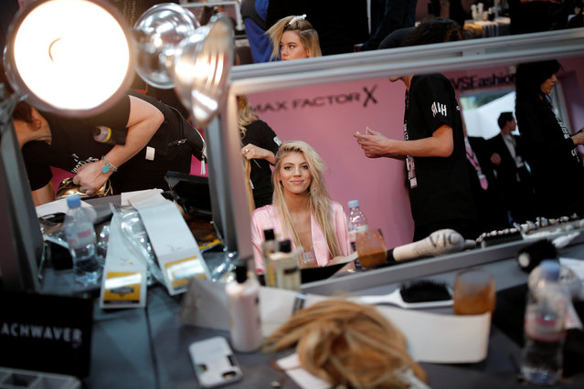 Model Devon Windsor gets ready backstage before the Victoria's Secret Fashion Show at the Grand Palais in Paris, France, November 30, 2016. (Photo by Benoit Tessier/Reuters)