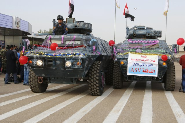 Troops of the Interior Ministry take part in a parade during a ceremony marking the Iraqi Police Day at a police academy in Baghdad January 9, 2016. (Photo by Khalid al Mousily/Reuters)