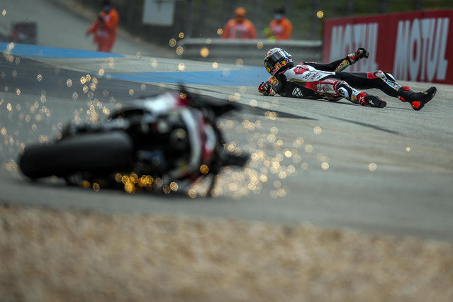 LCR Honda IDEMITSU's Japanese rider Takaaki Nakagami crashes in the second MotoGP free practice session of the Portuguese Grand Prix at the Algarve International Circuit in Portimao, on April 16, 2021. (Photo by Patricia de Melo Moreira/AFP Photo)