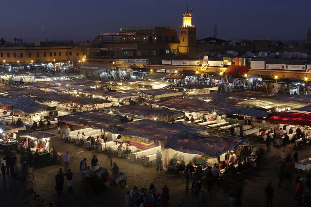 A view of Djamaa Lafna square and its restaurants in Marrakesh's old city December 18, 2014. (Photo by Youssef Boudlal/Reuters)
