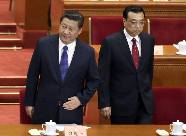 China's President Xi Jinping (L) and Premier Li Keqiang arrive for the opening session of the Chinese People's Political Consultative Conference (CPPCC) at the Great Hall of the People in Beijing, March 3, 2015. REUTERS/Jason Lee