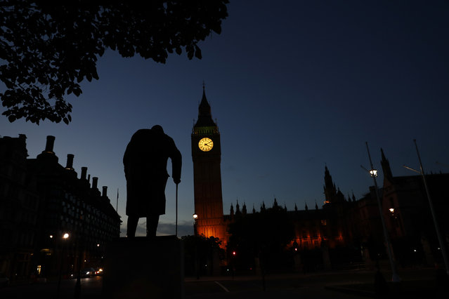 Dawn breaks behind the Houses of Parliament and the statue of Winston Churchill the day after the Brexit vote in Westminster, London June 24, 2016. (Photo by Stefan Wermuth/Reuters)