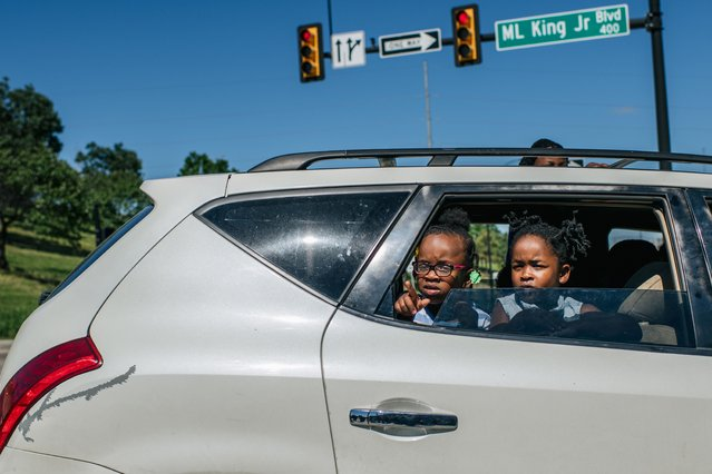 Children look on as members of the Black Panther Party and other armed demonstrators rally in the Greenwood district during commemorations of the 100th anniversary of the Tulsa Race Massacre on May 29, 2021 in Tulsa, Oklahoma. (Photo by Brandon Bell/Getty Images)