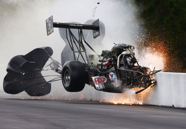 NHRA top fuel dragster driver Larry Dixon crashes after his car broke in half during qualifying for the Gatornationals at Auto Plus Raceway at Gainesville, FL, on March 14, 2015. Dixon walked away from the incident. (Photo by Mark J. Rebilas/USA Today Sports)