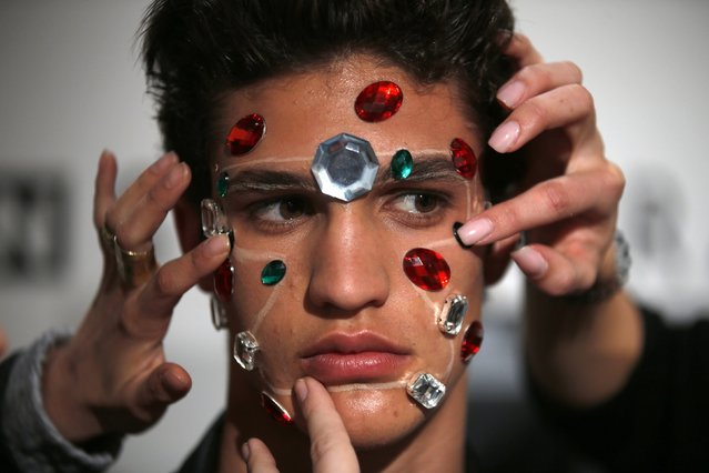 A model is prepared backstage before Nuno Gama show during Lisbon Fashion Week March 15, 2015. (Photo by Rafael Marchante/Reuters)
