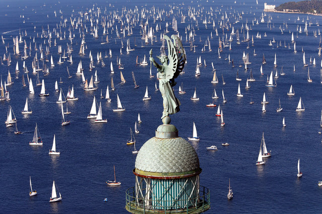 ITALY: Sailing boats gather at the start of the Barcolana regatta in front of Trieste harbour, Italy, October 9, 2016. (Photo by Stefano Rellandini/Reuters)
