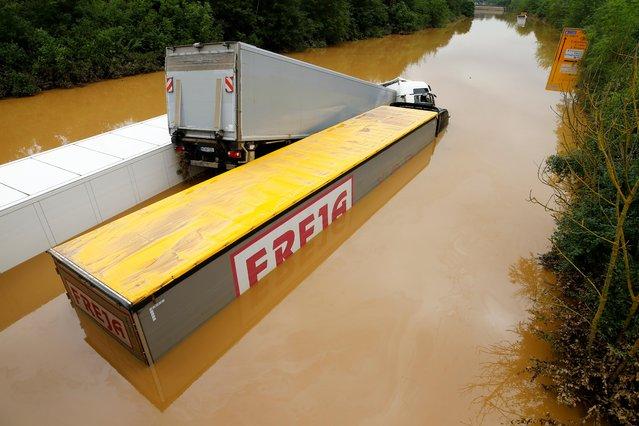 Trucks are stuck on a flooded street following heavy rainfalls in Erftstadt, Germany, July 16, 2021. (Photo by Thilo Schmuelgen/Reuters)