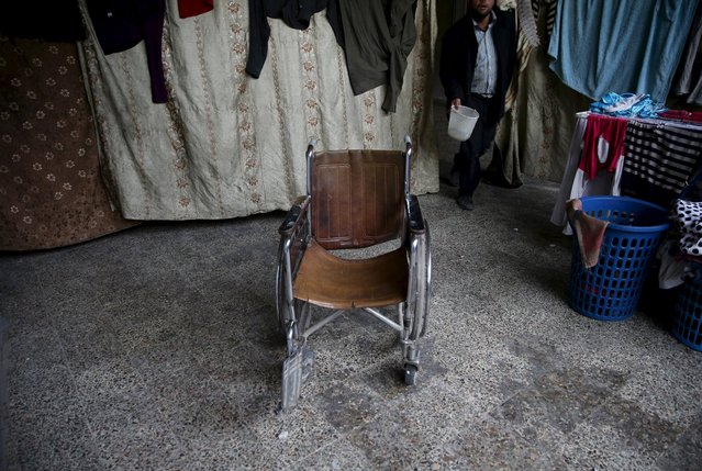 Shahrour's wheelchair is seen inside his home in the besieged town of Arbeen, in Damascus suburbs, Syria February 6, 2016. Shahrour said he developed diabetes at the beginning of the war in Syria. A lack of insulin led to his medical condition worsening and his right foot had to be amputated. Recently he also suffered a stroke that paralysed half his face. He and part of his extended family, a total of 18 people, live together and struggle to get by. (Photo by Bassam Khabieh/Reuters)