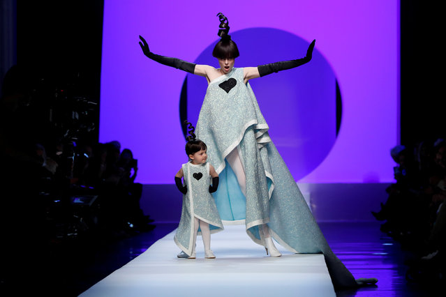 Model Coco Rocha and her daughter present creations by French designer Jean Paul Gaultier as part of his Haute Couture Spring-Summer 2018 collection in Paris, January 24, 2018. (Photo by Gonzalo Fuentes/Reuters)